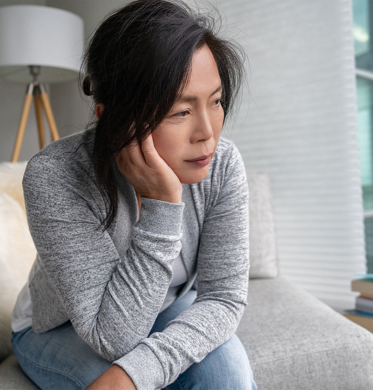 Asian woman in grey with hand on face looking exhausted. Whether its social anxiety, GAD, performance anxiety, or separation anxiety, an anxiety therapist who does psychotherapy can help you thrive again. Begin anxiety treatment in Torrance, CA today!