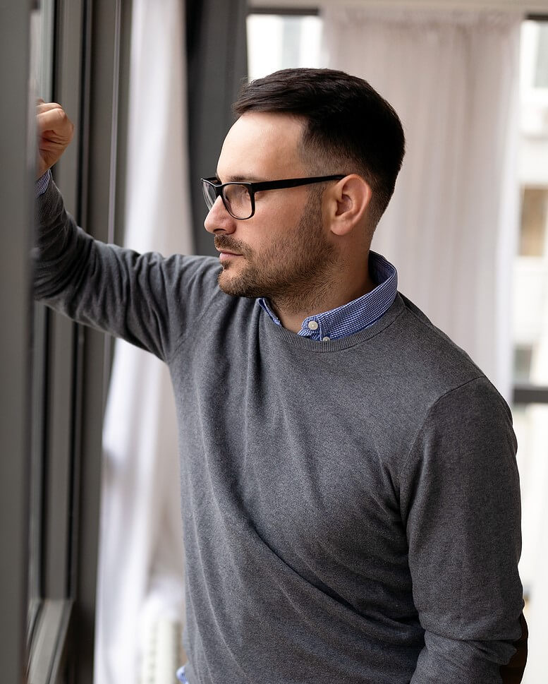Black man standing near counter and crossing arms frustrated. Relationships require communication whether that is with friends, family, coworkers, or partners. Get support with relationship therapy for singles. Dr. Carol is here to be your support in relationship therapy in Torrance, CA and surrounding Areas.